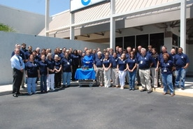 custom manufacturing and engineering comapny photo with all employees and power supply